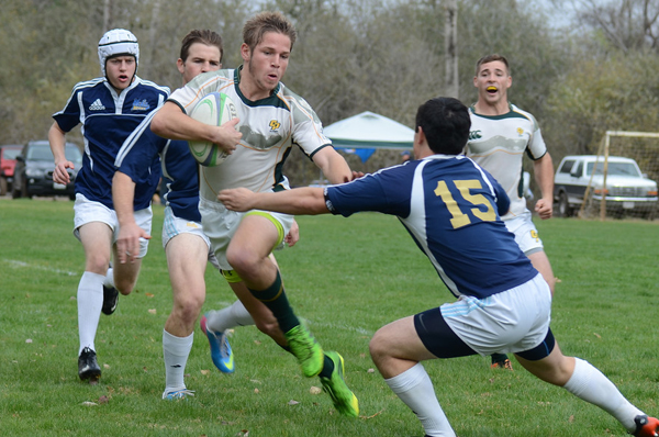 2nd XV Wing Matt Long step around the UCLA fullback to score outwide. Photo Leanna Long
