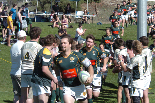 Cal Poly captain Alex Frost leads the Mustangs out against UCSB. Photo Jan Piper