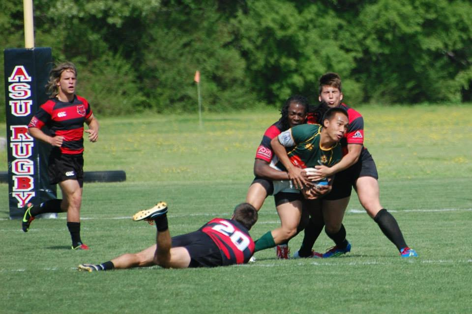 Cal Poly Flyhalf Kelii Dominguez doing all he can to escape the Red Wolves defense. Photo Rich Carvell Ark State.