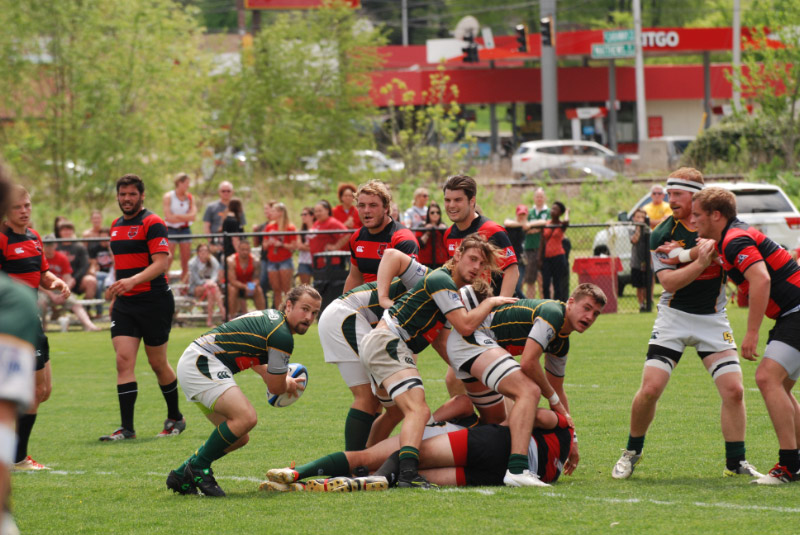 Scrumhalf Thomas Leacox clears the ball from the ruck. Photo Mike Nunno