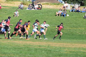 Senior prop Nathan Sylvia with a linebreak against Santa Clara. Photo Daniel Dempster